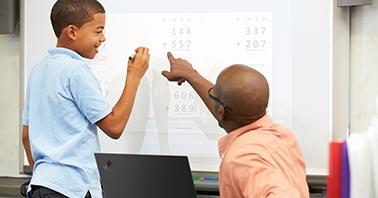 Teacher teaching with technology