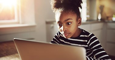 Transition to distance learning - Student on laptop at home