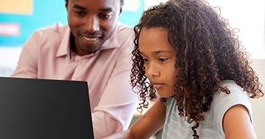 Classroom Management Platform - Teacher Helping Student on Laptop