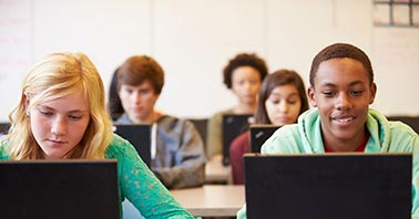 Students using content filtering on laptop
