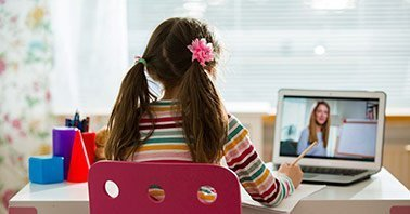 Distance learning solutions - Student learning on laptop