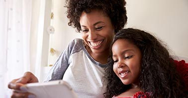 Parents' Guide to LanSchool - Mother and Daughter on tablet